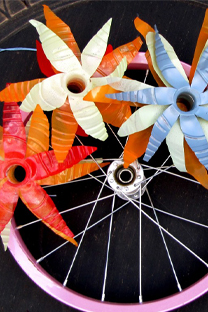 Bike wreath with plastic bottle flowers.