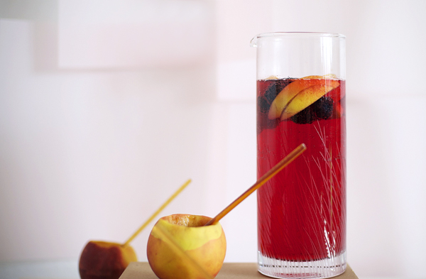 Mock raspberry + peach bellinis served in a cored out peach!