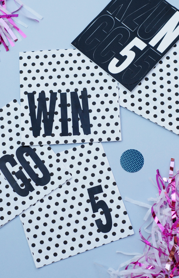 Make team spirit tailgate napkins by adding adhesive stickers to store bought paper napkins.