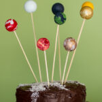 planet cake toppers and a milky way cake