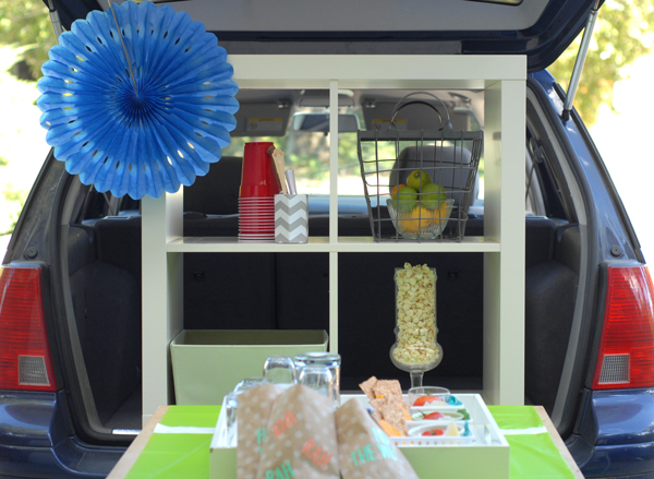Use a bookshelf for an instant tailgate bar set up!