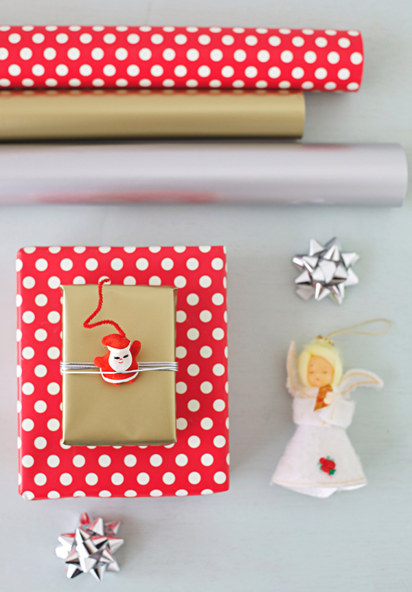 Use vintage ornaments for festive holiday wrapping.