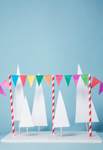 colorful party garland and paper trees