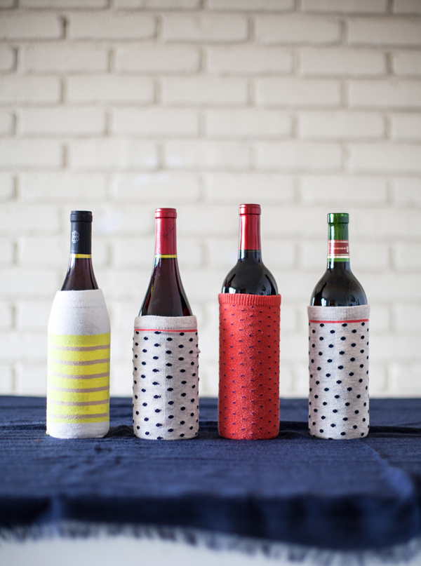 Wine bottles wrapped in socks for gifting!