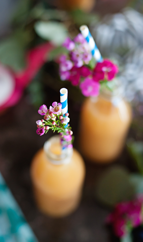 Flowers on straws for a spring party detail.