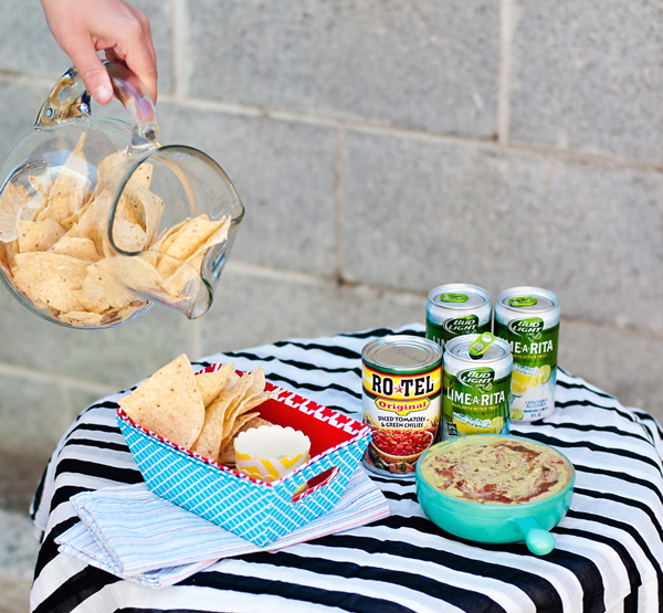 Genius party tip! Place chips in a pitcher instead of a bowl and pour for germ free serving.