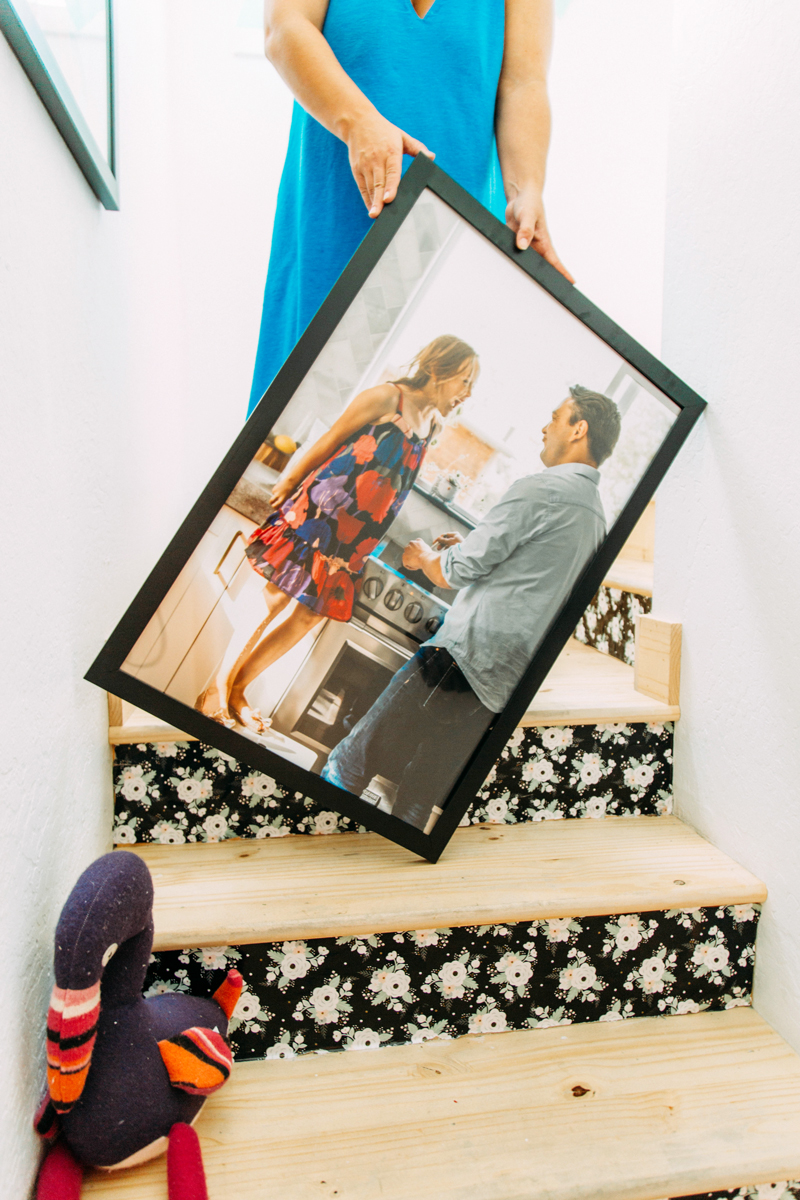 Family photos in a staircase done right