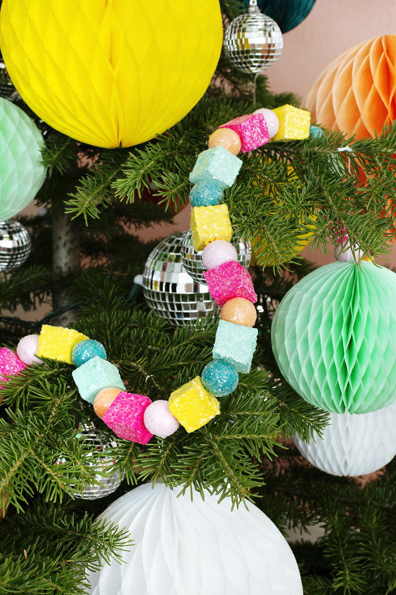 Decorating a tree with Sugar Plum Christmas Garland